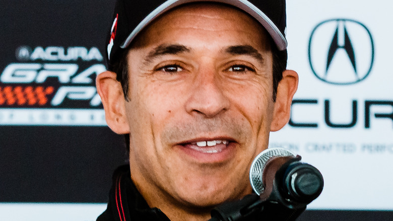 Helio Castroneves speaking at an event