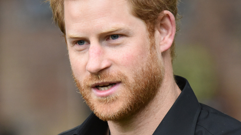 Prince Harry looking to the side with mouth slightly open