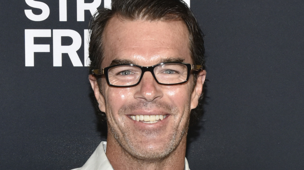 Ryan Sutter smiling on the red carpet