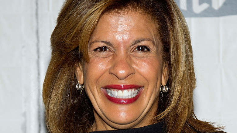 Hoda Kotb with wide smile and red lipstick