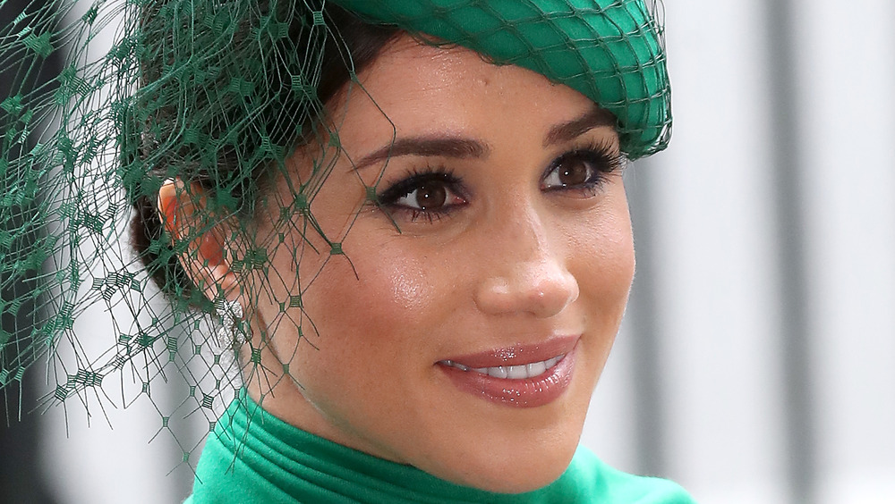 Meghan Markle wears a green headdress