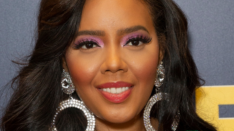 Angela Simmons smiles on the red carpet