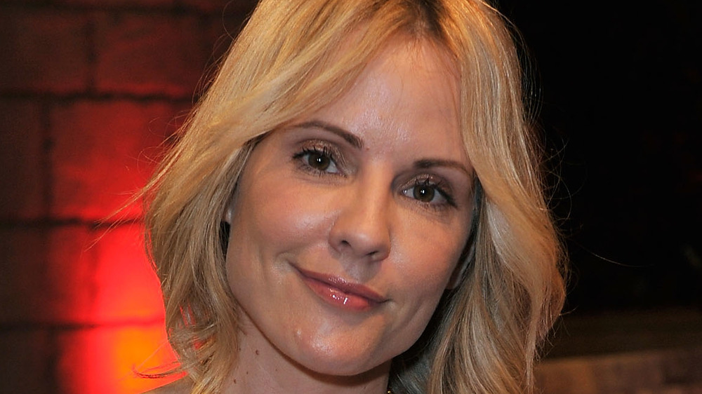 Emma Caulfield smiling at an event
