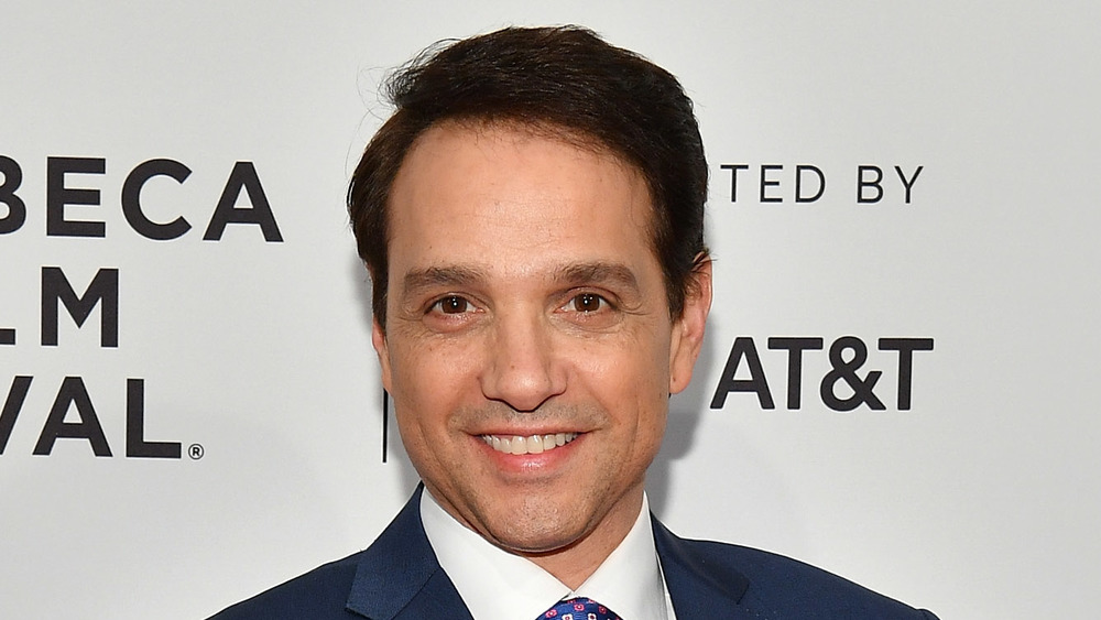 Ralph Macchio smiling on a red carpet
