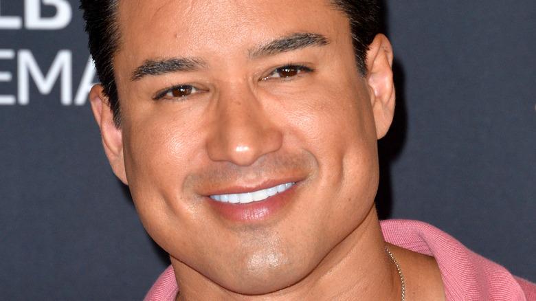 Mario Lopez smiles on the red carpet