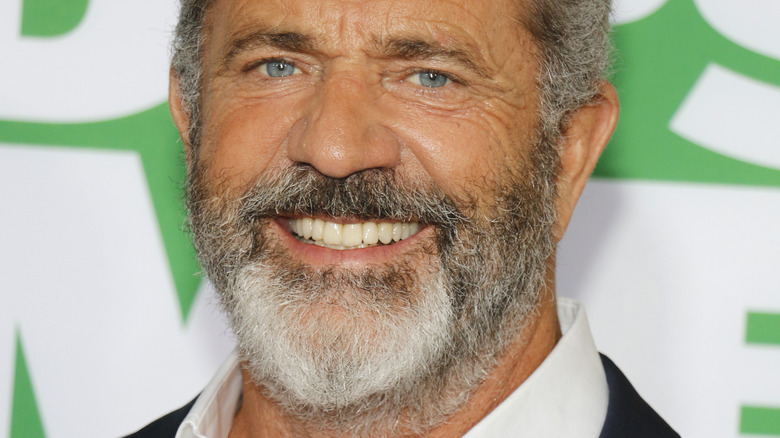 Mel Gibson smiling at red carpet event