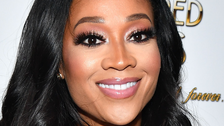 Mimi Faust smiling at 2019 book signing event