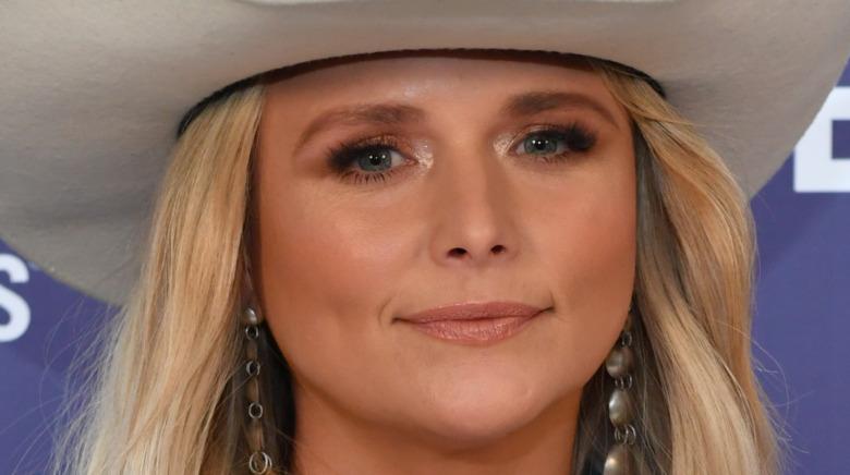 Miranda Lambert, smiling with no teeth, 2021 red carpet, wearing a cowboy hat