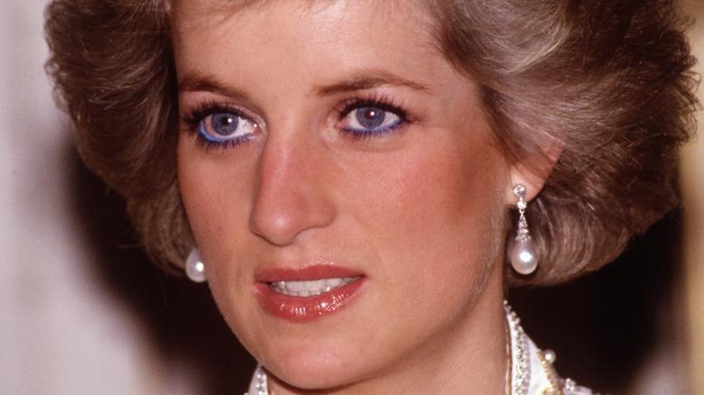 Princess Diana wearing pearl earrings.