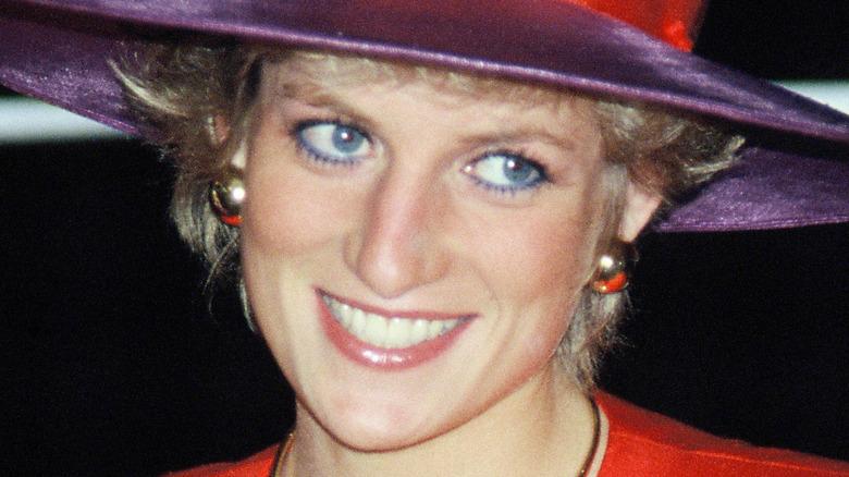 Princess Diana in a purple hat
