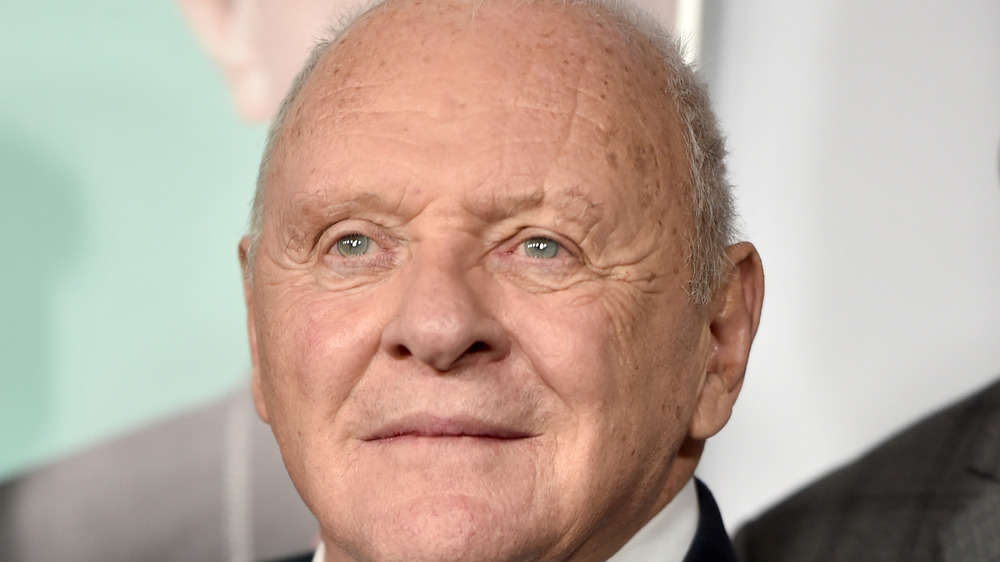 Anthony Hopkins, not smiling, red carpet, older, in a suit