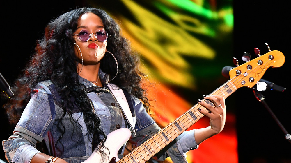H.E.R. plays guitar onstage