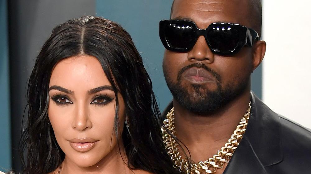 Kim Kardashian and Kanye West posing