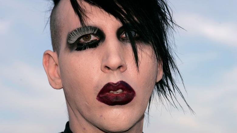 Marilyn Manson red lipstick black hair eyeliner