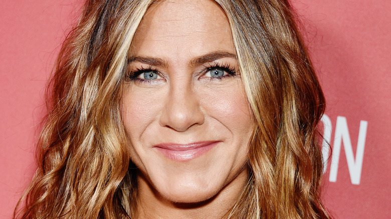 Jennifer Aniston, 2019 event, wavy brown hair down, smiling
