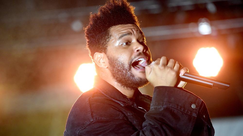 The Weeknd performing onstage in 2018