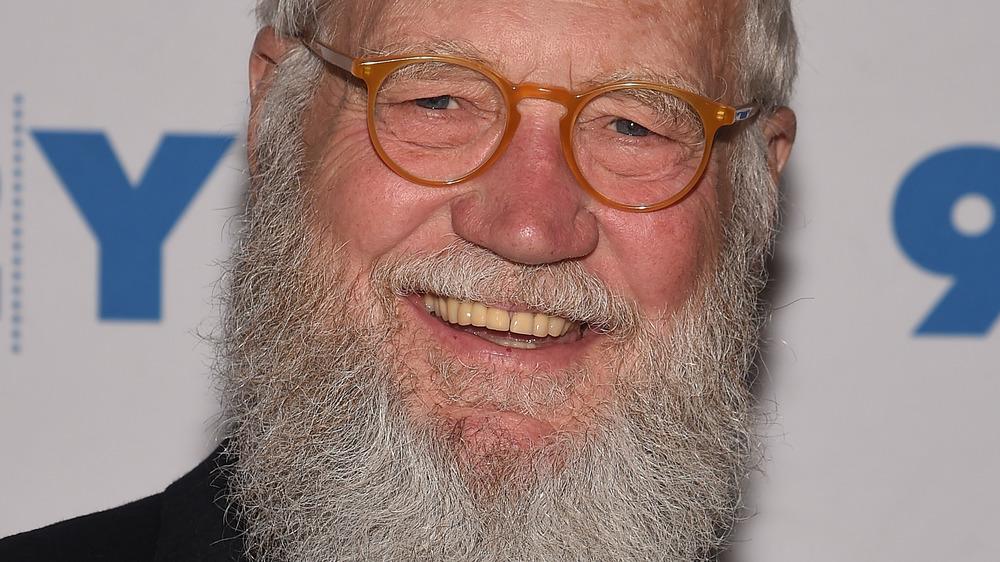 A bearded David Letterman smiling
