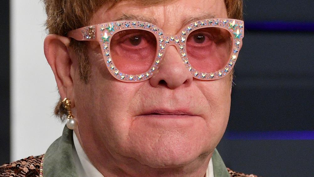Elton John staring
