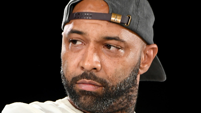 Joe Budden looking to the side with displeased expression