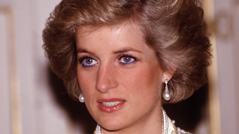 Princess Diana reacts while on a public engagement in the 1990s