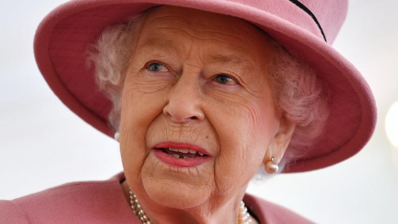 Queen Elizabeth II wearing pink hat