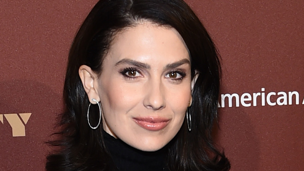 Hilaria Baldwin smiling for cameras at an event