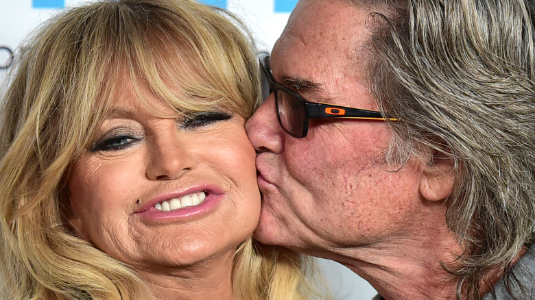 Goldie Hawn and Kurt Russell sharing a kiss