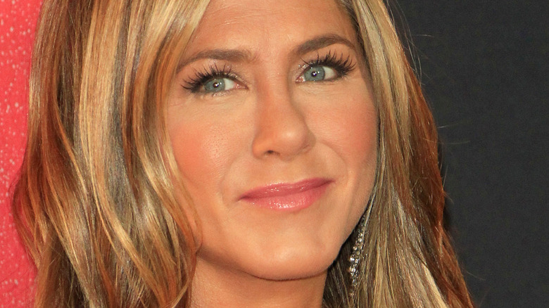 Jennifer Aniston poses in a black sequined dress.
