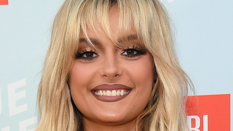 Bebe Rexha smiling on the red carpet