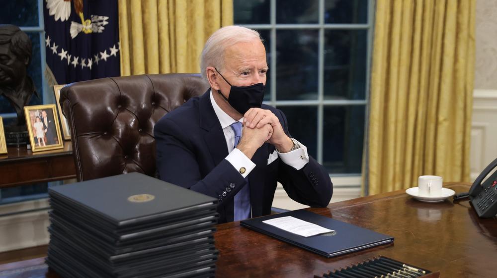 President Joe Biden sitting in the Oval Office