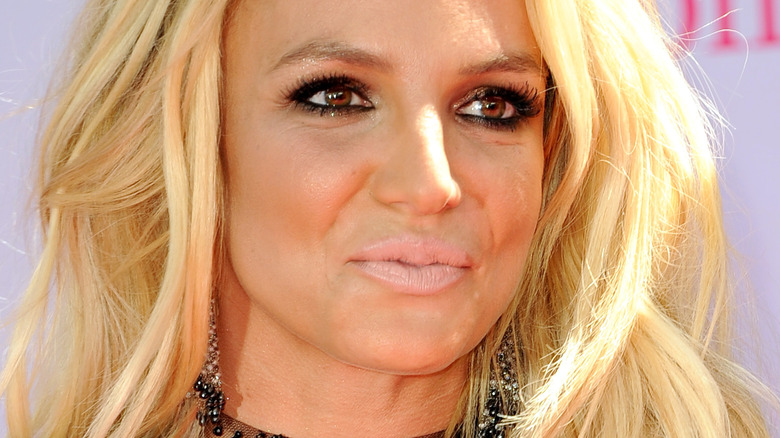Britney Spears looking to the side with light lipstick