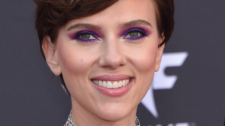 Scarlett Johansson smiling purple eye makeup