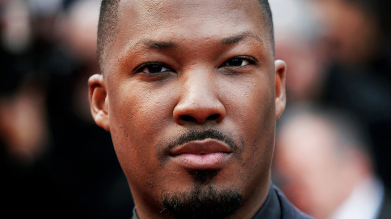 Corey Hawkins poses on the red carpet