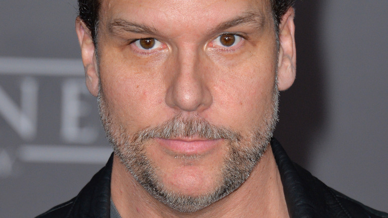 Dane Cook poses in a leather jacket in 2016
