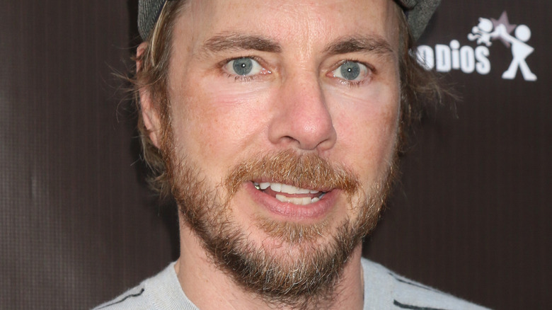 Dax Shepard smiling on red carpet
