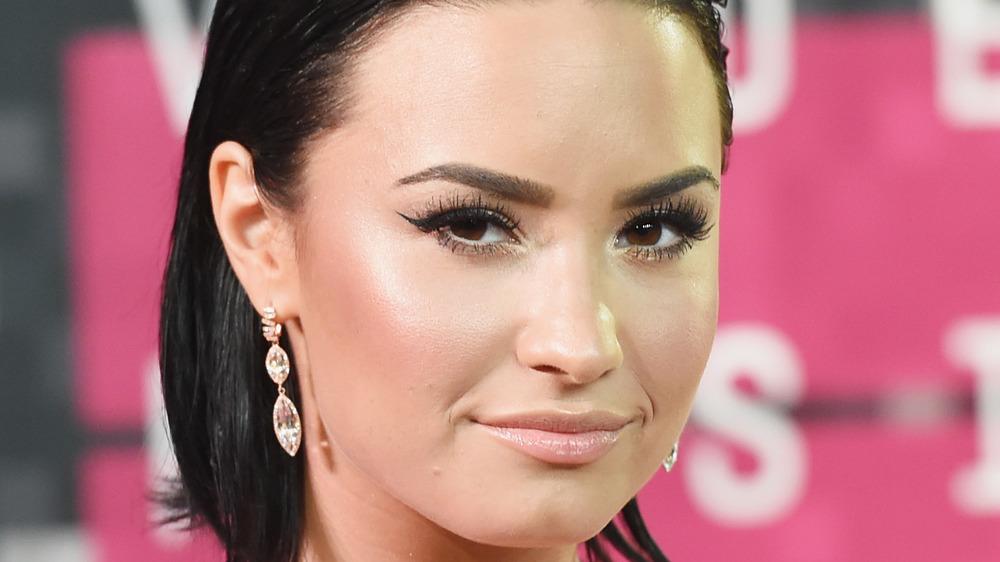 Demi Lovato smirking