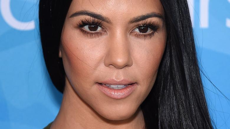 Kourtney Kardashian smiling slightly