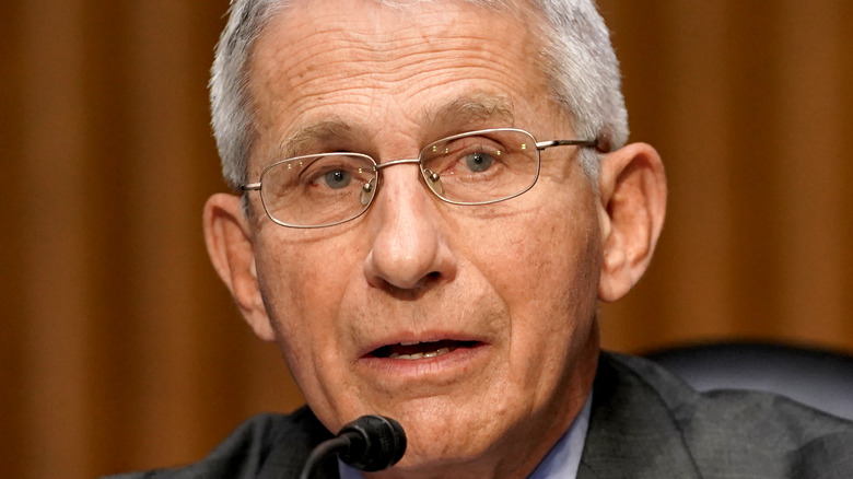 Dr. Fauci speaks at microphone