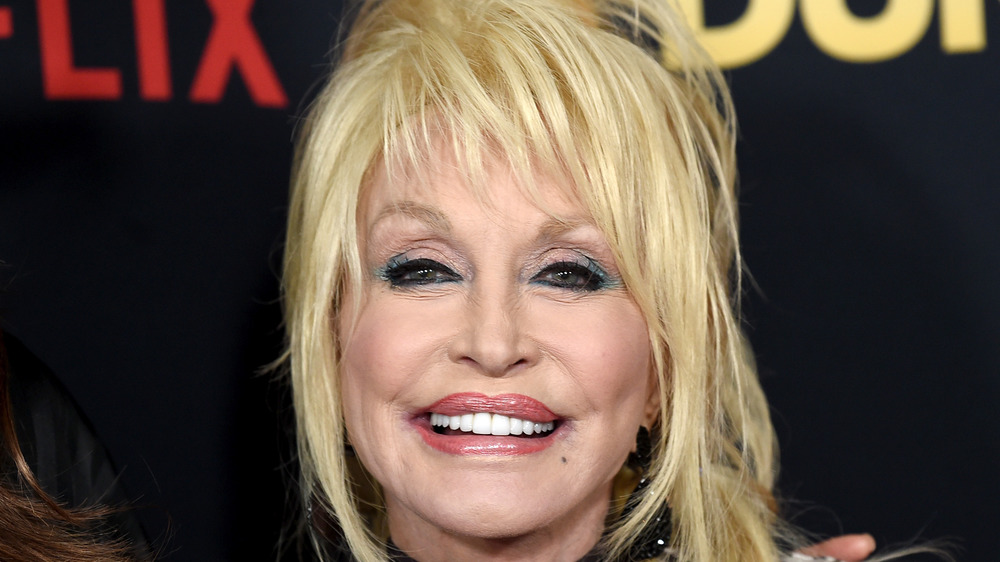 Dolly Parton smiling on a red carpet