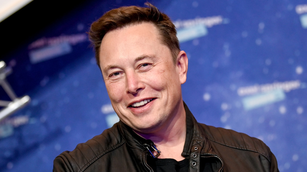 Elon Musk smiling at an event
