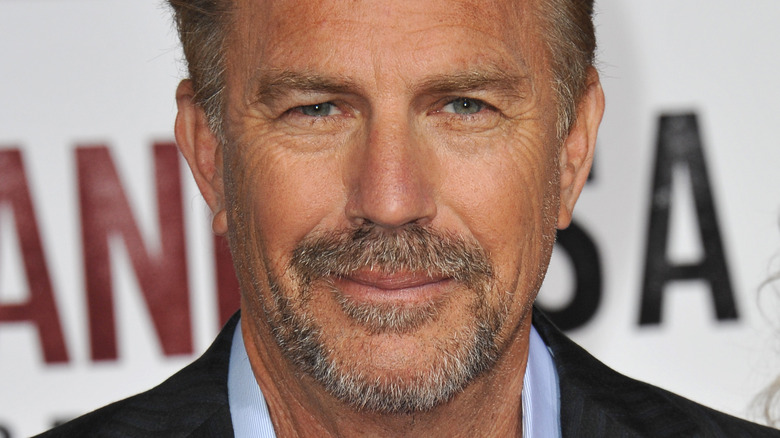Kevin Costner poses in a suit in 2015.