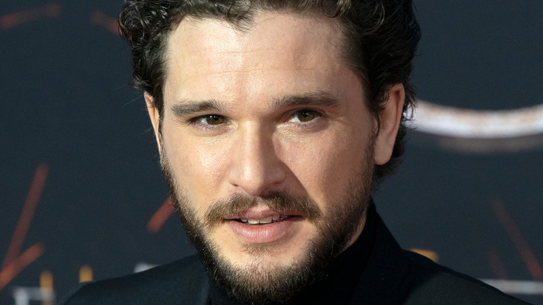 Kit Harington looking to the side with slight smile