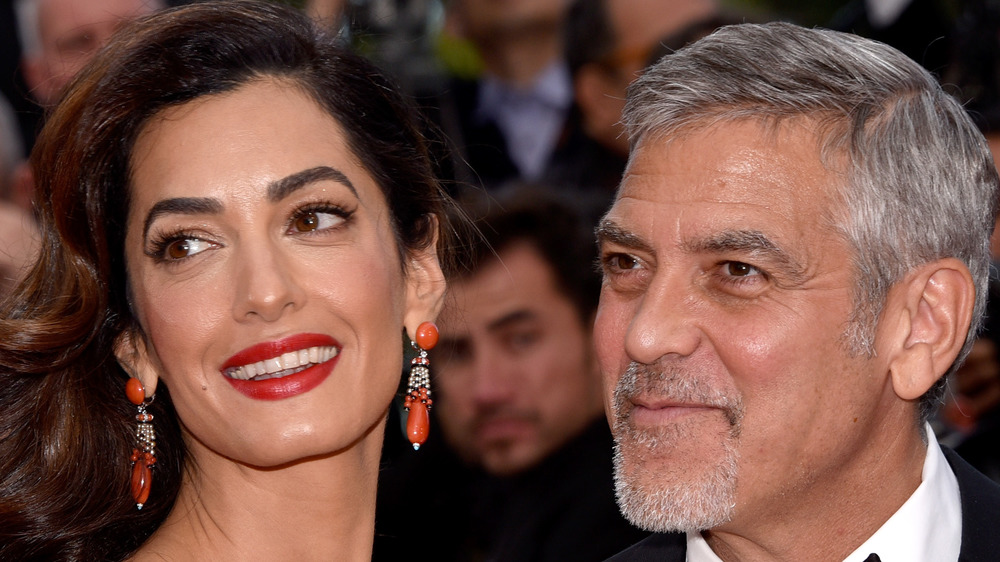 George and Amal Clooney smiling