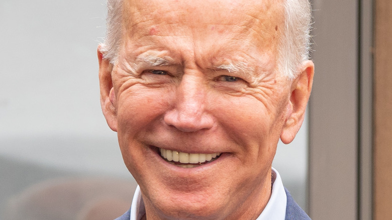 Joe Biden smiles at a conference