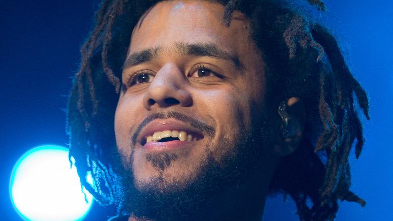 J. Cole smiling