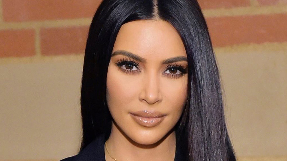 Kim Kardashian poses at an event