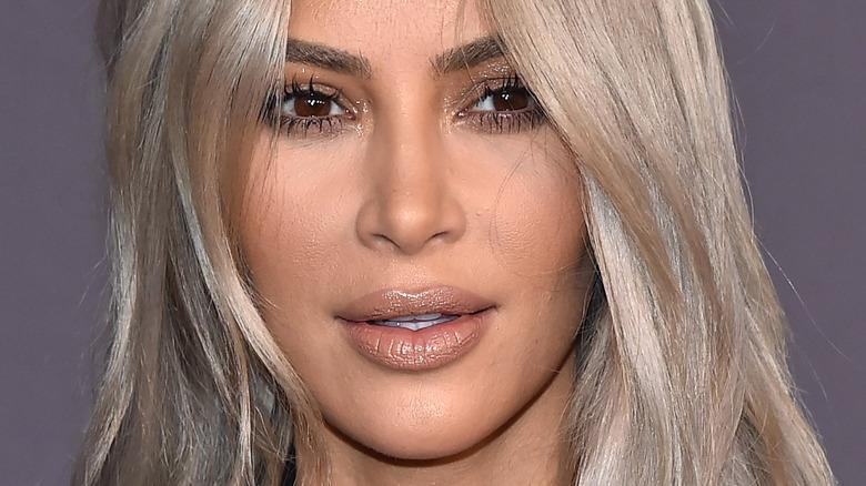 Kim Kardashian smiling with blonde hair