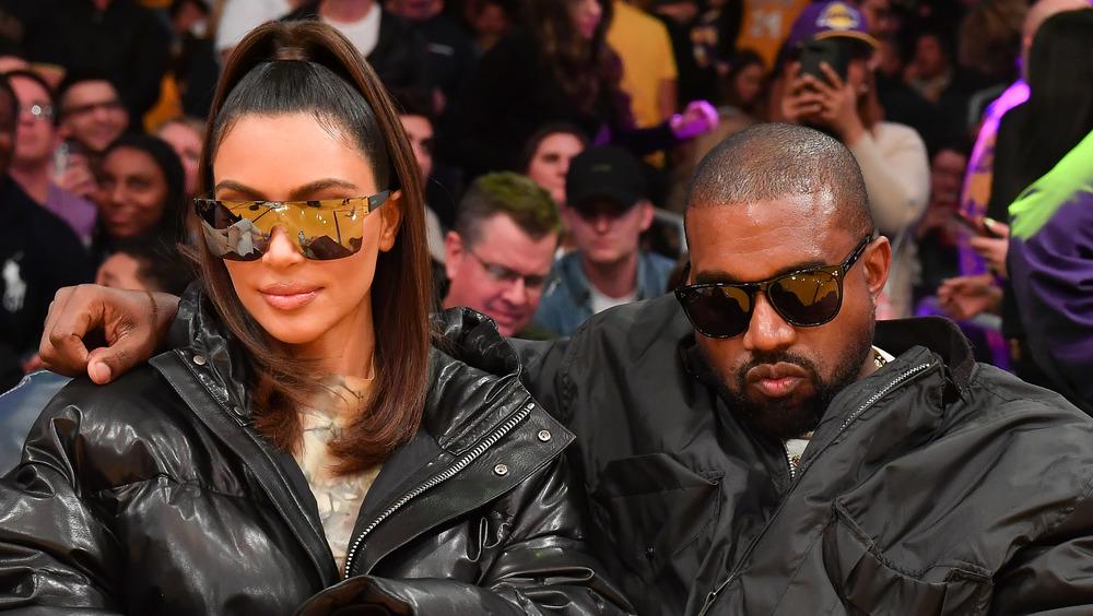 Kim Kardashian and Kanye West at a Laker's game
