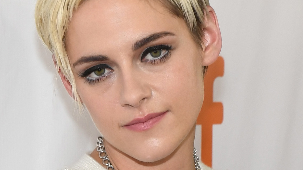 Kristen Stewart gives a slight smile for the cameras on the red carpet