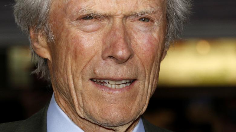 Clint Eastwood staring and smiling slightly